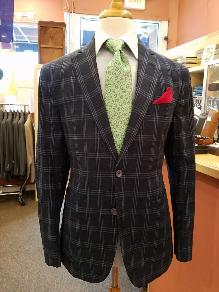 For a cool summer look, you can wear an unconstructed sportcoat with a bright tie. Depending on the occasion, you may want to add a pocketsquare for added flair.