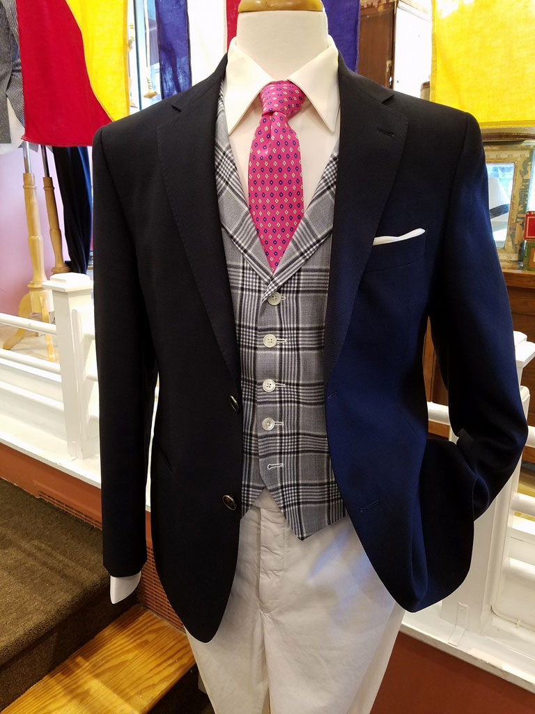 A Navy Blazer can be worn in many different ways. You can dress up a Navy Blazer with a white pair of pants, a vest, and bright tie. This is a good example of such an outfit. It is perfect for Cocktail Parties, and Afternoon Weddings.
