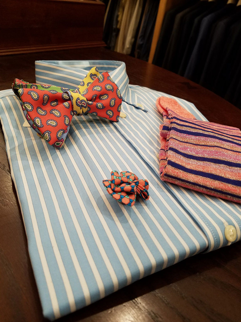 A striped summer shirt could be worn as is with dress slacks, jeans, or under a navy blazer. It can be accessorized with a bowtie for a pop of color. Matching socks are a nice touch.